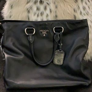 Black Prada shoulder bag.